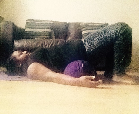 Supported Bridge Pose With Bolster
